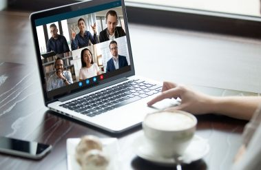 A video meeting on a laptop